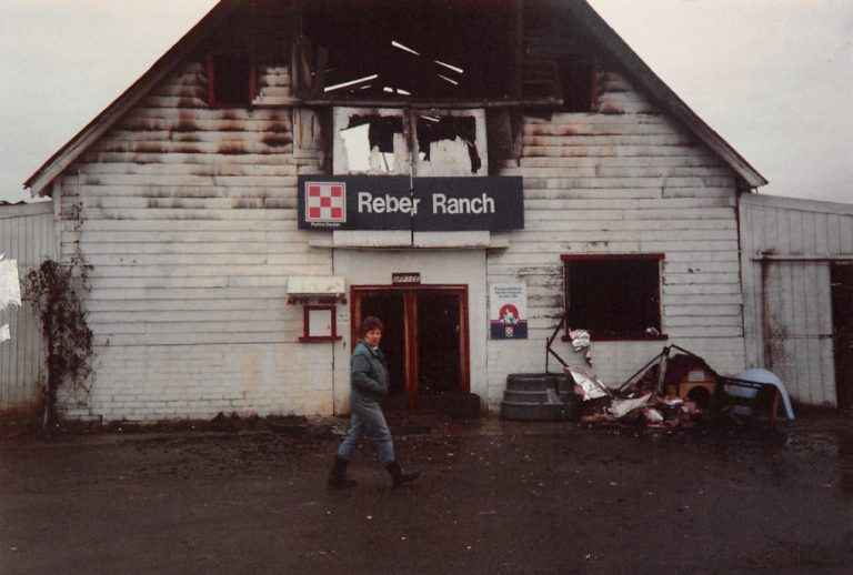 Sally with old burned Reber Ranch store